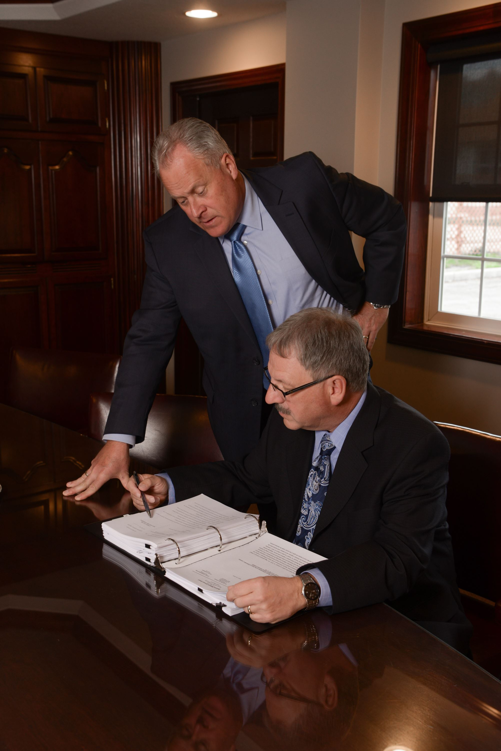 Rexford Hagg and John Dorsey reviewing a case