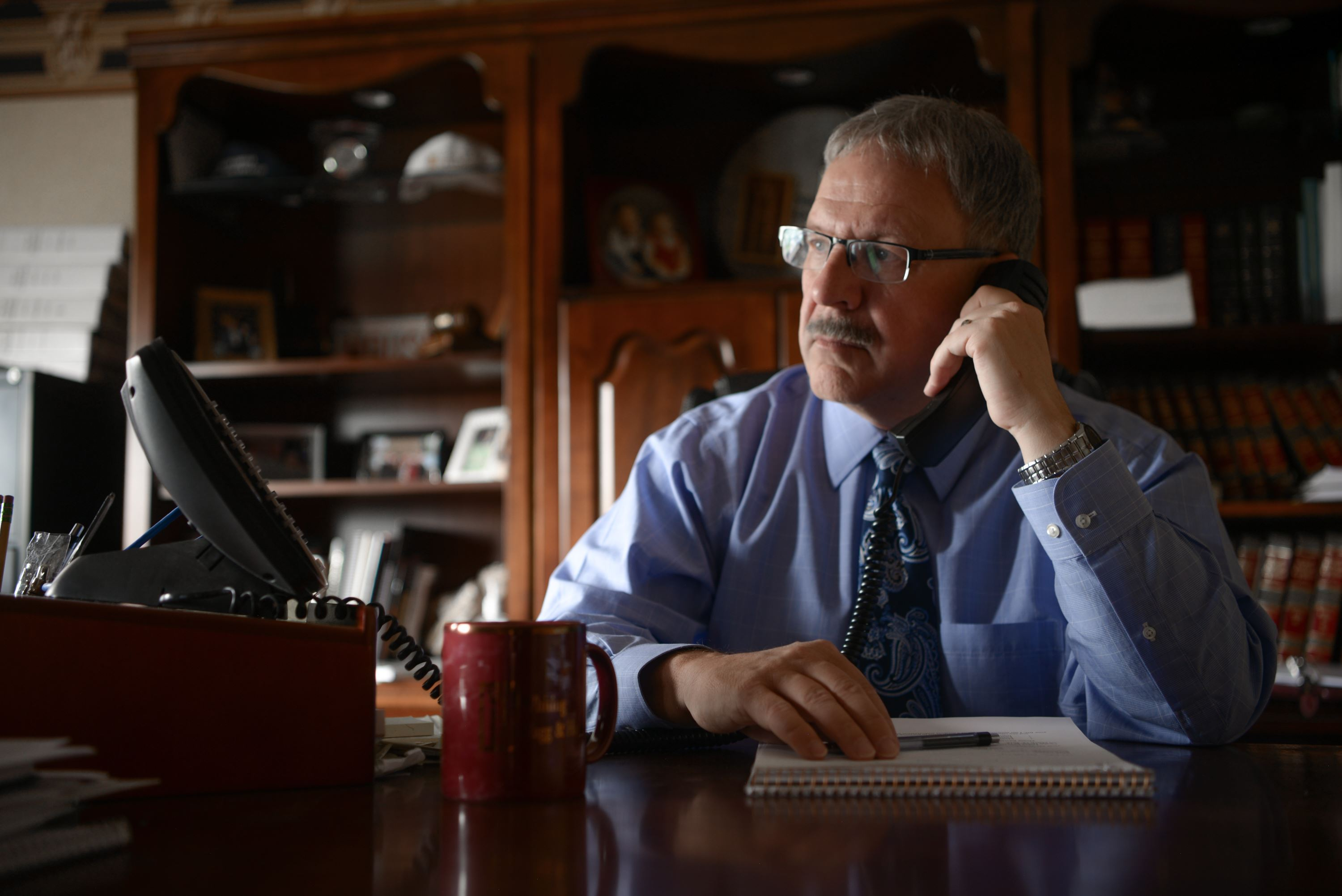 Attorney Rexford Hagg on the phone with a client